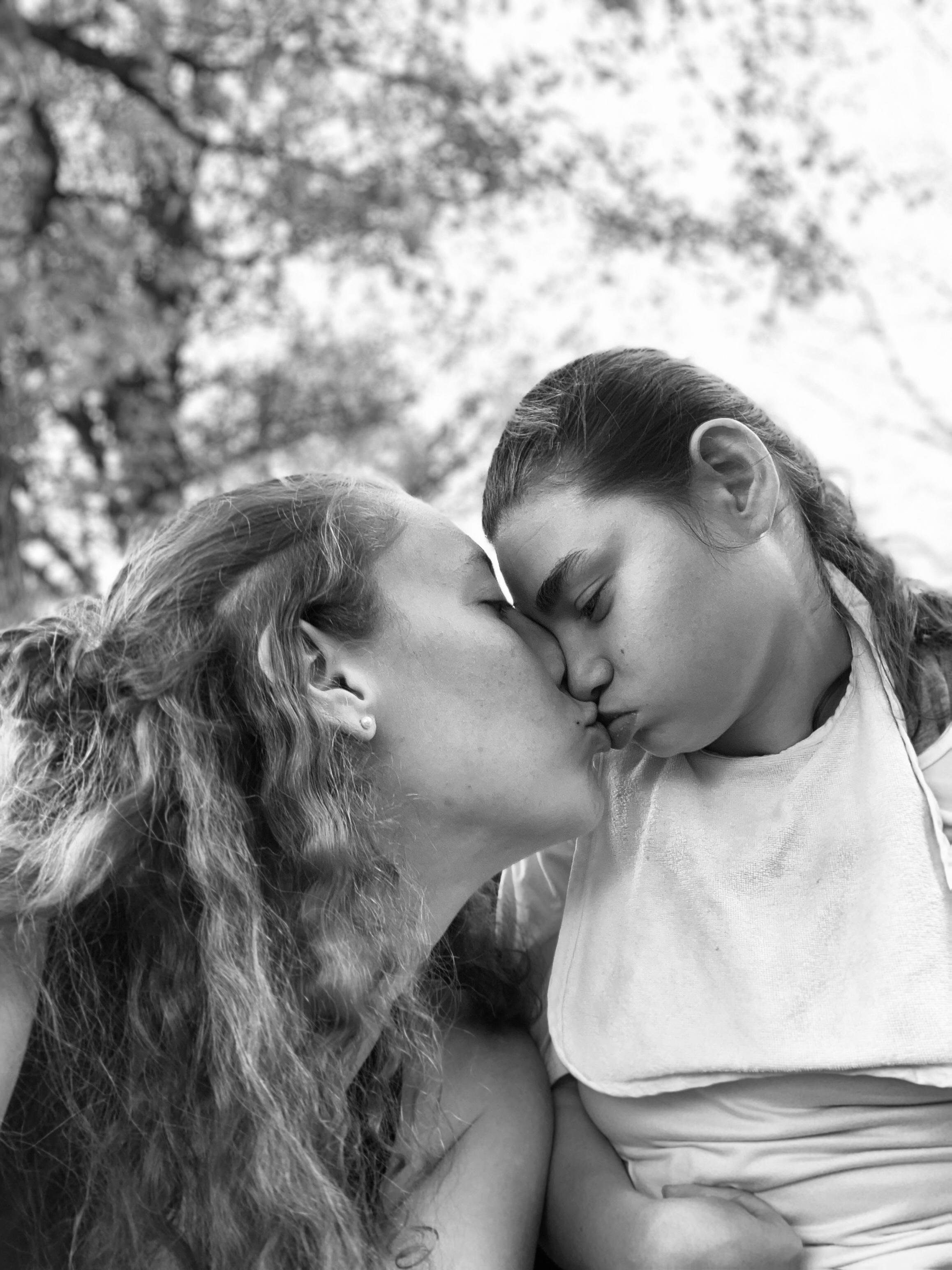Amy kissing Kyia